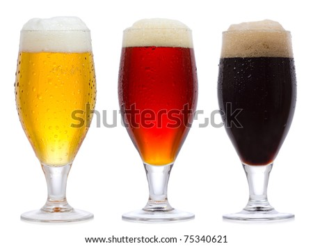 glasses of beer on white background - stock photo