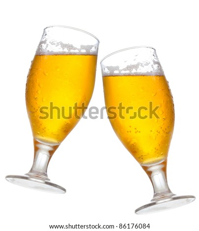 glasses of beer on white background