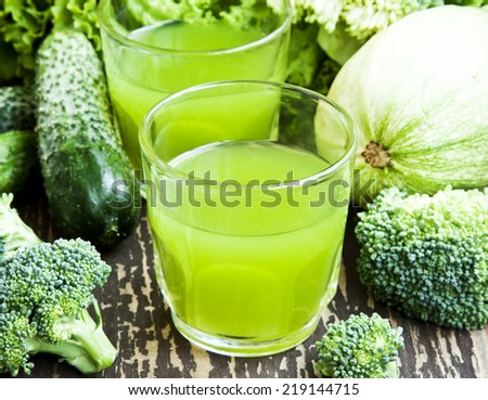 Glasses of Bio Green Vegetables Healthy Juice with Broccoli, Cucumber and Lettuce - stock photo