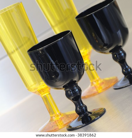 Glasses of black and yellow crystal on the table