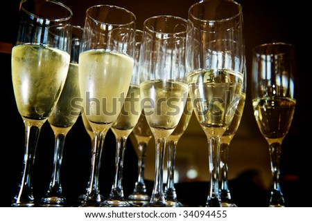 glasses of bubbly shot from below - stock photo
