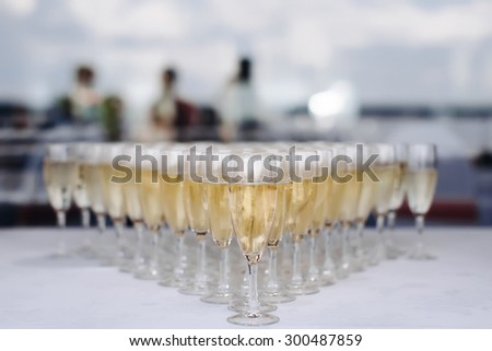 glasses of champagne alcohol cocktail wedding - stock photo