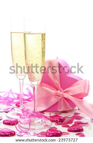 Glasses of champagne and gift box on white - stock photo