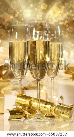 Glasses of champagne and gifts for new years celebrations - stock photo