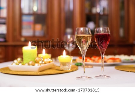 Glasses of champagne and kir royale cocktail - stock photo
