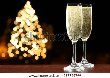 glasses of champagne and xmas tree  - stock photo