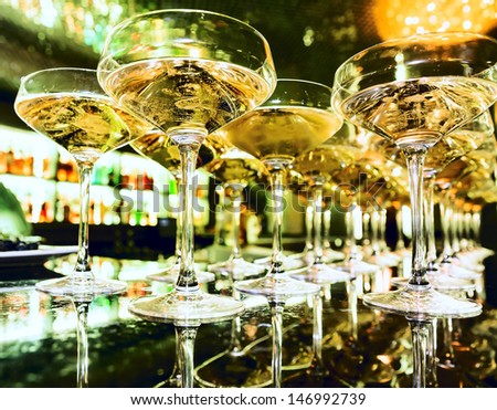 Glasses of champagne at the bar in festive evening. Soft focus - stock photo