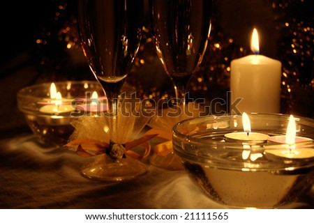 glasses of champagne, candles with christmas decorations