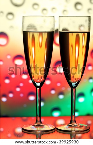Glasses of champagne close-up over background with bubbles - stock photo