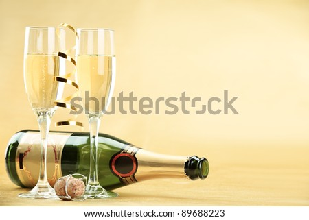 Glasses of champagne in holiday setting - stock photo