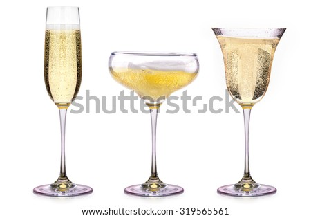 Glasses of champagne isolated on a white background - stock photo