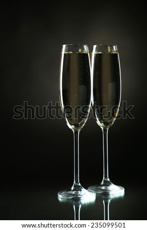 Glasses of champagne on a black background