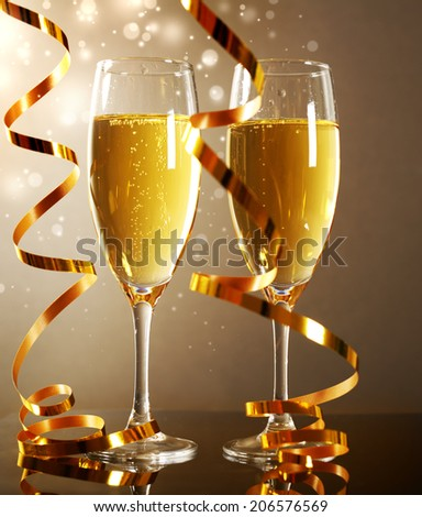 Glasses of champagne on dark background - stock photo