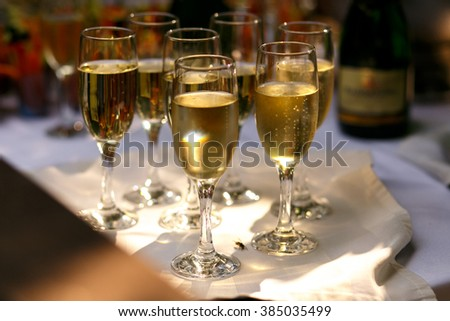 Glasses of champagne on the table at luxurious wedding ceremony - stock photo