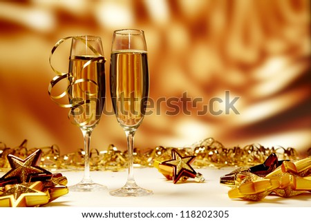 glasses of champagne on yellow background - stock photo