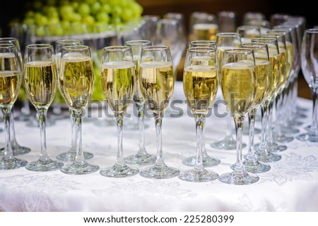Glasses of champagne waiting for guests - stock photo
