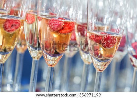 glasses of champagne with a large depth of field - stock photo