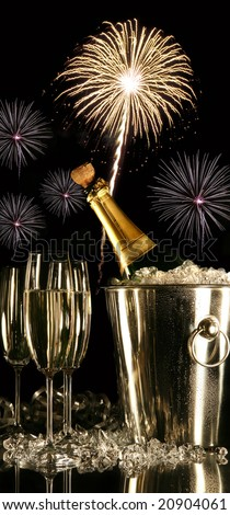 Glasses of champagne with fireworks on black background - stock photo