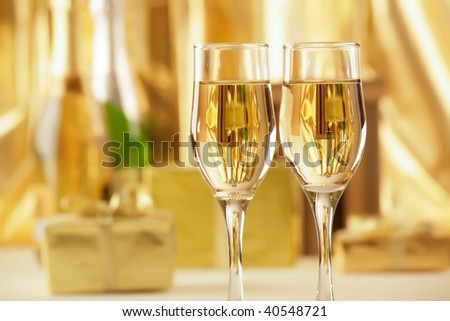 Glasses of champagne with gold gifts. New year