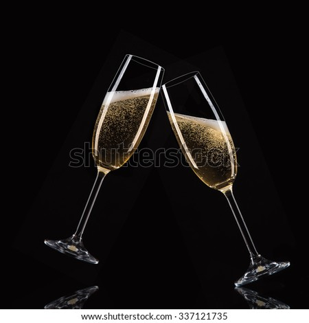 Glasses of champagne with splash, celebration theme. - stock photo