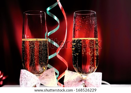 Glasses of champagne with Valentine Day decorations, close up - stock photo