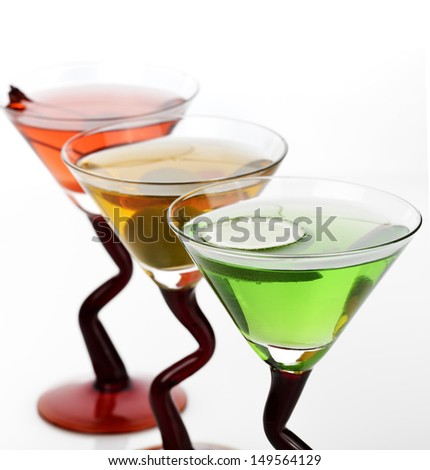 Glasses Of Cocktail Drinks On White Background - stock photo