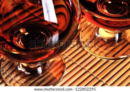 Glasses of cognac on the table - stock photo