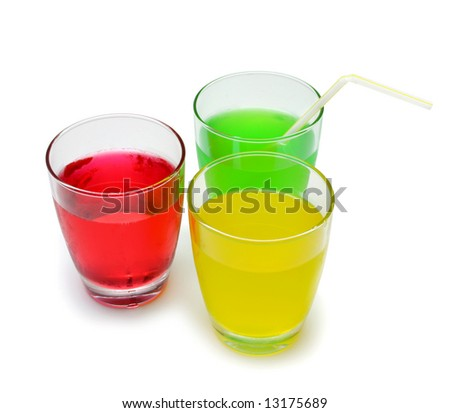 Glasses of coloured soft drink on white - stock photo