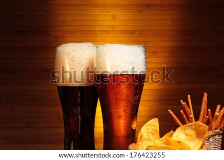 Glasses of dark and light beer, close up - stock photo