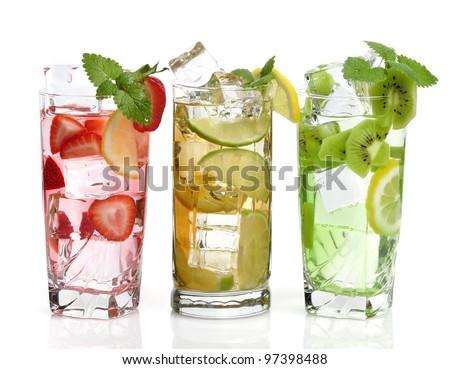 Glasses Of Drink With Ice Cubes And Fruits On White Background - stock photo
