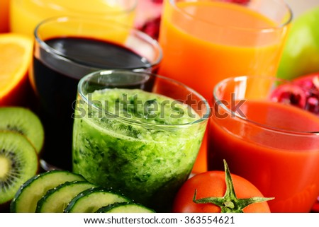 Glasses of fresh organic vegetable and fruit juices. Detox diet. - stock photo