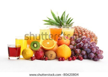 Glasses of fruit juice with fruits on a white background - stock photo