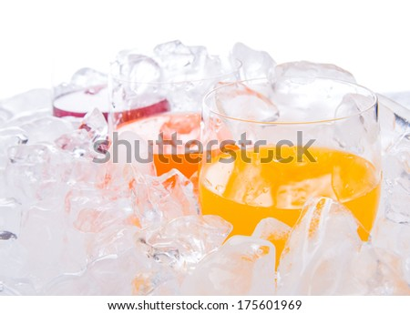 Glasses of grape, mango and orange juice chilled with ice cubes - stock photo