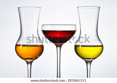 Glasses of grappa on a grey background - stock photo