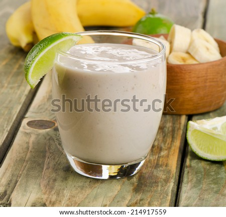 Glasses of healthy  Banana smoothie with lime . Selective focus