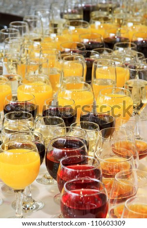 glasses of juice and wine at the banquet - stock photo