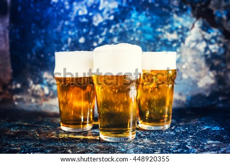 Glasses of lager beer, light beers served cold at pub - stock photo