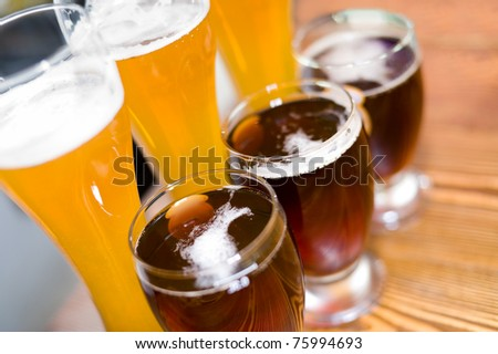 glasses of  light and brown ale (beer) - stock photo