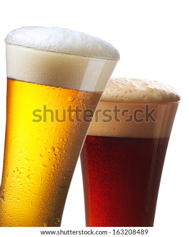 Glasses of light and dark beer on white background - stock photo