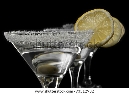 glasses of martini on a black background - stock photo