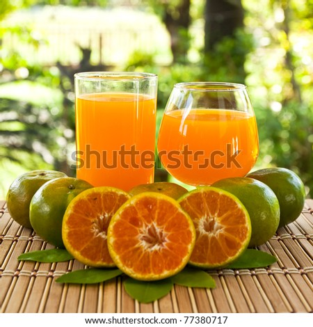 glasses of orange juice and fruits, high vitamin C