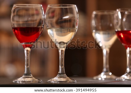 Glasses of red and white wine closeup