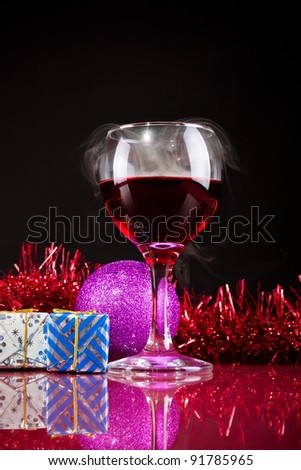 glasses of red wine on a black background