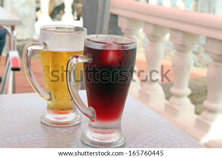 Glasses of sangria and beer - stock photo