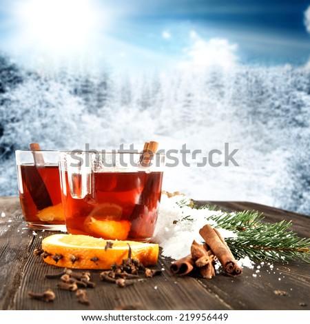 glasses of tea and orange  - stock photo
