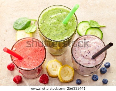 glasses of various smoothies with straws for healthy dieting breakfast - stock photo