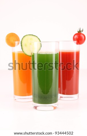 glasses of vegetables juice on white