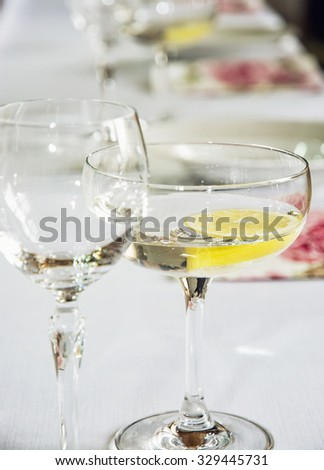 Glasses of vermouth with lemon for birthday party. - stock photo