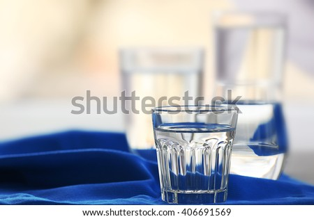 Glasses of water on a  napkin, close up