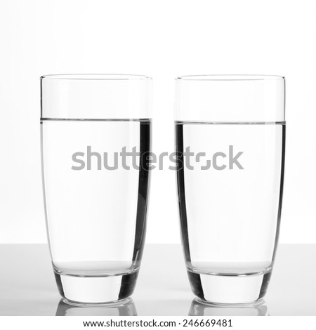 Glasses of water on light background - stock photo